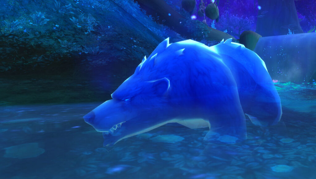 Ringo, as a big blue bear, stands in the stream, fishing.